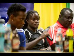 Marvin Morgan (centre) of Arnett Gardens FC responds to a question from a member of the audience at the Red Stripe Premier League press conference held at Jamaica Football Federation in New Kingston on Friday, March 15, 2019.