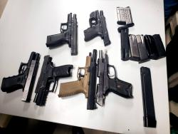 Six firearms were discovered in a barrel at the Freeport wharf in Montego Bay, St James, yesterday.