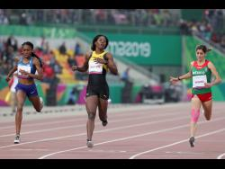Shericka Jackson ofJamaica (centre) wins the gold medal in the women's 400m at the Pan American Games in Lima, Peru, yesterday.