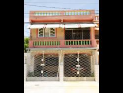 Photo shows the home of the Manning family in Cumberland, Portmore.