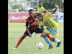 Romario Campbell (right), then of Waterhouse FC, tries to evade Arnett Gardens FC's Lennox Russell during a Red Stripe Premier League game at the Anthony Spaulding Sports Complex on Sunday, January 22, 2017. File