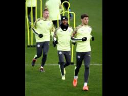 Manchester City's Kevin De Bruyne, Raheem Sterling (centre), and John Stones (right) during a team training session at the City Football Academy in Manchester, England, on Monday, November 25, 2019.