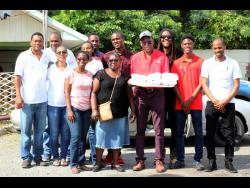 The Spatial Innovision team gets ready to go out and deliver food throughout the Swallowfield community.