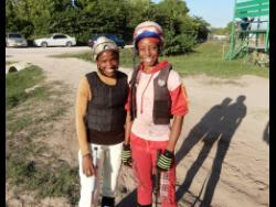 Photo By Robert Bailey Female apprentice jockeys Abigail Able (left) and Tamicka Lawrence.
