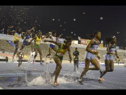 St Jago's Jameaka Manning competes in the girls' 2000m steeplechase with Edwin Allen High's Kayan Green (second right) and Jeima Davis (right) at the 2017 ISSA/GraceKennedy Boys and Girls' Championships.