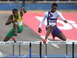 From left: Excelsior'High School's Devontie Archer with Kingston College Shantamoi Brown in the boys 15-16 400m hurdles , at the GC Foster Classics at the National Stadium on March 11, 2018.