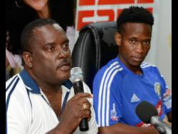 David Galloway (left) manager of Mount Pleasant Football Academy and player Cordel Benbow.