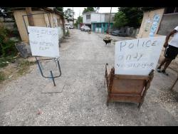 The checkpoint in the Old Road community in Thompson Pen, Spanish Town.