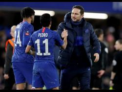 Chelsea's head coach Frank Lampard (right) shakes hands with Pedro following their 2-0 win over Liverpool in the English FA Cup fifth-round match at Stamford Bridge stadium in London on March 4,2020.