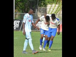 Members of the Kemar Brown- coached Cumberland High School Manning Cup team celebrate after scoring a goal against St George's College in the first round of the ISSA/Digicel Manning Cup football competition in 2018.