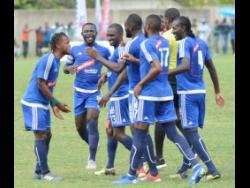Members of Mount Pleasant celebrate a goal in a Red Stripe Premier League match