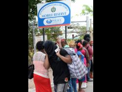 File photo shows deportees leaving Harman Barracks after being deported to Jamaica.