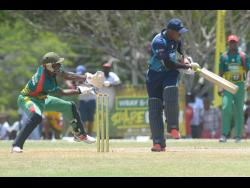 File Johnson Mountain's Jair Campbell in action against Gayle at the Ultimate Cricket Oval in St Ann last year.