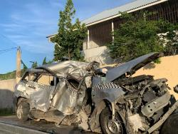 The wreckage of the Nissan motor car in which the family was travelling along the Rose Hall main road in St James.