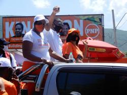 The People's National Party's Phillip Paulwell, who has been the Member of Parliament for East Kingston and Port Royal for the past 23 years, on his way to the nomination centre on Windward Road yesterday. He is flanked by councillors Loraine Dobson (left) and  Jacqueline Lewis.