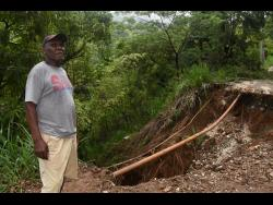 Zephianiah Slater looks at some of the damage that was caused by heavy rains from Tropical Storm Laura.