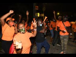 PNP supporters awaiting the final results adjacent to the Linstead courthouse in St Catherine North West.