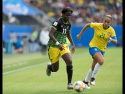 File Khadija Shaw (left) dribbles the ball away from Brazil's Monica last year in the FIFA Women's World Cup.