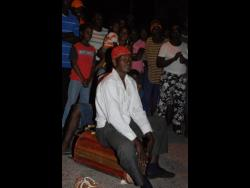 A drummer in the Wakefield Tambo Group performing at a wake.