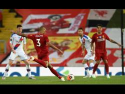 Liverpool's Fabinho scores his side's third goal during the English Premier League match between Liverpool and Crystal Palace at Anfield Stadium in Liverpool, England, Wednesday, June 24, 2020.