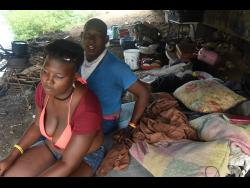Karen and her husband Shawn relax in the place they call home -  under the bridge in Edgewater, Portmore, St Catherine.