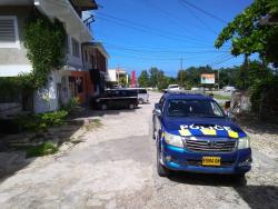 A police service vehicle outside of Country's Supermarket in Hopewell, Hanover, where two of five gunmen who held up and robbed the establishment on Saturday, were shot.