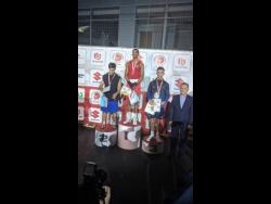 File Jamaica's Joshua Frazer (second left) stands atop the  podium after beating Marat Gashimov (left) in the final of the Leszek Drogosz Memorial International Boxing Tournament in Kielce, Poland, on October 25, 2019.