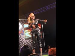 Candy K competing in the 2014 edition of Magnum Kings & Queens of Dancehall, which she won.