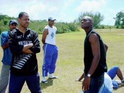 File Former St Elizabeth Technical High School, Jamaica, and United States cricketer Richard Staple (centre).
