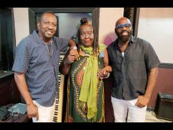 Little Lenny (left), Yvonne Sterling (centre) and Richie Stephens have collaborated on a new song. Little Lenny and Stephens were among the first persons to assist Sterling in her moment of need.