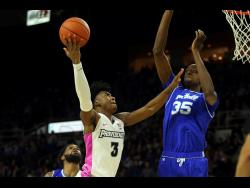 Seton Hall's Romaro Gill (35) blocks a shot by Providence's David Duke (3) during the second half of an NCAA college basketball game on February 15, 2020.