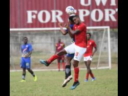 File Molynes United's Nicholas Nelson (left) goes up for a header against UWI's Sheldon McKoy  in their Red Stripe Premeir League encounter at the UWI Bowl on Sunday,January 26,2020.