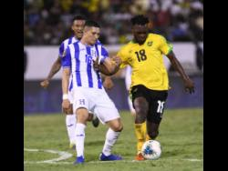 Honduras player Hector Castellanos (left) tries to dispossess Jamaica's Brian Brown in a Concacaf Gold Cup match at the National Stadium in 2019.
