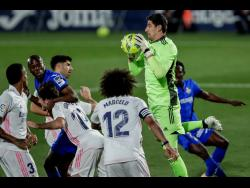 Real Madrid's goalkeeper Thibaut Courtois catches the ball during the Spanish La Liga match between Getafe and Real Madrid at the Alfonso Perez stadium in Getafe, Spain, yesterday.