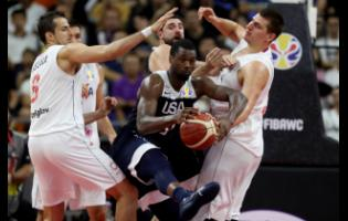 United States' Harrison Barnes tries to break through Serbia's players during a consolation play-off game for the FIBA Basketball World Cup in Dongguan in southern China's Guangdong province yesterday.