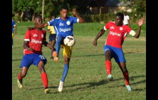Delroy Trowers (centre) from Hydel High controls the ball in the midst of the Camperdown pair of Cafu Washington (left) and Jeovanni Laing in a ISSA/Digicel Manning Cup  first-round match at Caymanas Bay, St Catherine on Friday, September 13, 2019.