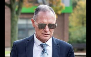 Former England football player Paul Gascoigne arrives at Teesside Crown Court in Middlesbrough, England yesterday where he is appearing on charges of sexually assaulting a woman on a train.