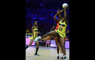 Jamaica goal shooter Jhaniele Fowler (right) acrobatically grabs a pass while her teammate Shanice Beckford looks on during their Vitality Netball World Cup fifth place play-off at the M&S Bank Arena in Liverpool, England on July 21, 2019.