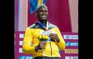 Jamaica's Fedrick Dacres displays his discus throw silver medal after the presentation ceremony at the Khalifa International Stadium in Doha, Qatar on October 1, 2019.