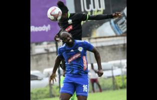 Mount Pleasant's Francios Swaby (front) challenges Andrew Peddlar of Molynes United for the ball during their Red Stripe Premier League match at Drewsland on October 6.