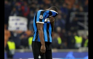 Inter Milan's Romelu Lukaku covers his face at the end of the Champions League Group F match between Inter Milan and F.C. Barcelona, at the San Siro stadium in Milan, Italy, yesterday.