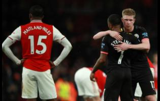 Manchester City's Kevin De Bruyne celebrates with teammate Raheem Sterling at the end of the English Premier League match against Arsenal, at the Emirates Stadium in London yesterday.
