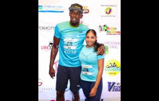 Usain Bolt and Kasi Bennett.