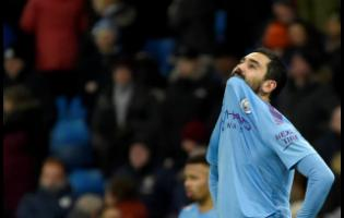 Manchester City's Ilkay Gundogan reacts at the end of the English Premier League match between Manchester City and Crystal Palace at Etihad stadium in Manchester, England, on Saturday, January 18.