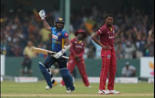 Sri Lanka's Wanidu Hasaranga (left) celebrates scoring the winning run to defeat the Windies by one wicket as Keemo Paul (right) looks on in disappointment in their first one-day international cricket match in Colombo, Sri Lanka, on Saturday.