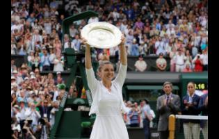AP In this Saturday, July 13, 2019 file photo, Romania's Simona Halep holds up the trophy after defeating American Serena Williams in the women's singles final match at the Wimbledon Tennis Championships in London.