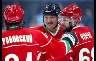 In this photo taken on Saturday, March 28, 2020, Belarusian President Alexander Lukashenko (centre) takes part in a hockey match during Republican amateur competitions in Minsk, Belarus.