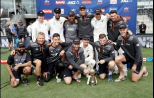 The New Zealand team posing with their trophy after winning a recent Test series against India 2-0.