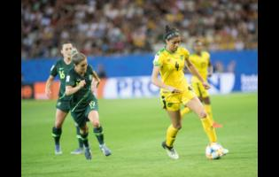 Chantelle Swaby (right) dribbles towards goal ahead of Australia's Katrina Gorry (left) during last year's FIFA Women's World Cup in Grenoble, France.