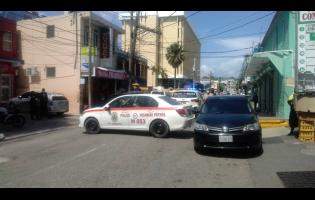 The crime scene in Montego Bay yesterday where robbers shot a security guard.